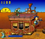 Tin Star SNES Standing on top of the stagecoach.