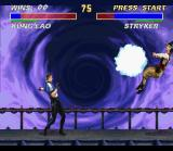 Ultimate Mortal Kombat 3 SNES Stryker throws a bomb at Kung Lao