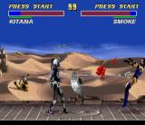 Ultimate Mortal Kombat 3 SNES Smoke grabs Kitana with his robotic claw