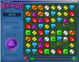 Bejeweled Deluxe Windows Score big points by causing a chain reaction with falling jewels.