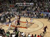 NBA 2K9 Windows Crowded in front of the basket.