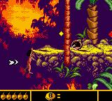 Walt Disney's The Jungle Book: Mowgli's Wild Adventure Game Boy Color Mowgli hanging on; collect that token!