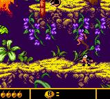 Walt Disney's The Jungle Book: Mowgli's Wild Adventure Game Boy Color Jumping on a foe.