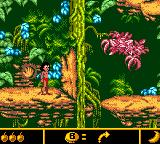 Walt Disney's The Jungle Book: Mowgli's Wild Adventure Game Boy Color Press that button to open the door, here in Rainbow Jungle.