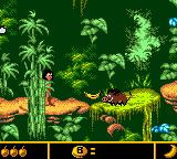 Walt Disney's The Jungle Book: Mowgli's Wild Adventure Game Boy Color Throwing a banana at a warthog.