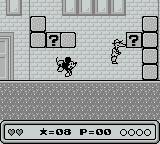 Mickey's Dangerous Chase Game Boy Lobbing a block at a suspicious character.