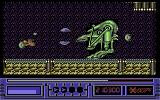 X-Out Commodore 64 Stage 4 Boss - Mechanoid green thing with a teeny tiny head.
