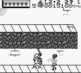Wizards & Warriors X: Fortress of Fear Game Boy Attacking a skeleton