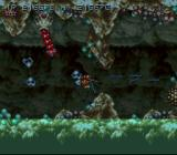 Axelay SNES Stage 4 - Lots of strange creatures. The blue creatures pull your ship down.