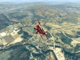 Flight Unlimited DOS Flying over Springfield in the Pitts.