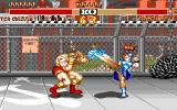 Street Fighter II Amiga Zangief is blocking Chun Li's Lightning Kick.