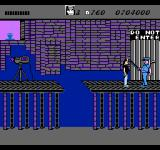 Wayne's World NES Wayne is stopped by a security guard.