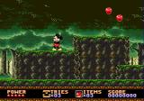 Castle of Illusion starring Mickey Mouse Genesis Forest level. If you eat those apples, you can throw them at enemies afterwards