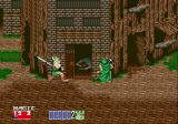 Golden Axe II Genesis The dwarf threatens the poor green mage in a village