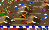 Race Mania DOS The arena, a helicopter throws nitro power-ups onto the track