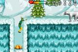 Elf: The Movie Game Boy Advance Bouncing on a gum drop with a polar bear nearby