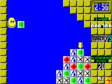 Plotting ZX Spectrum To hit the green block on top the player must fire their block at the wall so that it drops down onto the target. The arrow shows where it will fall