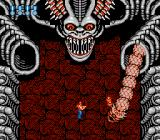 Super Contra NES This guy isn't that tough. The snake goes into the other hole after crawling around for a while