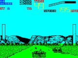 Chase H.Q. II: Special Criminal Investigation ZX Spectrum Caught the wagon, now to do damage. The small round objects in front of the chase car are shots that missed and hit the road. Good job standard ammo is not limited