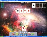Ultimate Solitaire 1000 Windows laying Canfield with a Galaxy background and a familiar imported picture has been used as the card back.