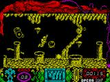 Mutan Zone ZX Spectrum Spaceman cannot walk past that crater / column and must jump. He cannot maneuver while in the air so must take a run at it and jump while moving