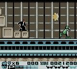 Men in Black: The Series 2 Game Boy Color Taking on an alien in the cargo hold.