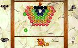 Fruit Salad DOS Level 2: showing a fruit in flight and the top of the screen descending like a fruit press. There are four black balls on this level that don't match any fruit.