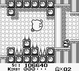 Kirby's Dream Land Game Boy Hovering over deadly spikes in a castle.
