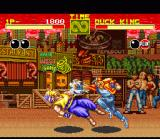 Fatal Fury SNES Round 2 of the same fight. Note how the background has changed; this battle takes place in the evening instead of the afternoon