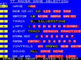 TT Racer ZX Spectrum This is the race setup screen. The keys on the left scroll through the text / options on the right, e.g. 3 cycles the race tracks, 4 selects the number of laps while 6&7 set up a network game.