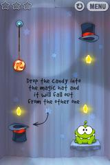 Cut the Rope iPhone Level 7-1, drop the candy into the magic hat and it will fall out from the other one