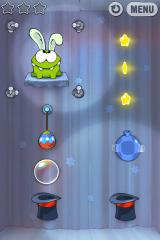 "Cut the Rope iPhone Level 7-7, tap the candy on the title screen for an ""easter egg"", the bunny ears sometimes randomly appear when idle"