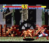 Fatal Fury 2 SNES Mai Shiranui vs. first boss Billy Kane in front of the Tower Bridge