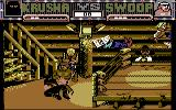 Sgt Slaughter's Mat Wars Commodore 64 The native American wrestler tosses Krusha out of the ring