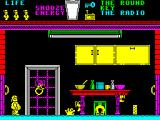 Pyjamarama ZX Spectrum Screen 2. There are beasties moving up and down. There are hands that come up from the floor. The object is to get across to the other side of the screen and open the door