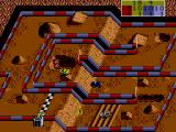 Ivan 'Ironman' Stewart's Super Off Road SEGA Master System Gray truck in the lead