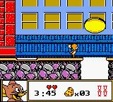 Tom & Jerry Game Boy Color A moving coin on the street? Well, never mind. That's just one of the many obstacles in the game. Remember, in this situation, timing is key!