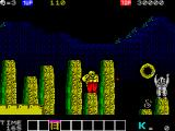 Karnov ZX Spectrum The ladder has been collected and now appears in the inventory. There's a bomb power up over to the right near the baddie who's throwing great stone balls at Karnov