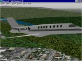 Microsoft Flight Simulator 98 Windows The Learjet 45 in flight with landing gear retracted