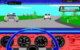 Test Drive II Scenery Disk: California Challenge DOS Trying not to attract attention from the cops by going slowly (EGA)