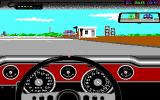 Test Drive II Scenery Disk: California Challenge DOS Approaching San Francisco. The opponent is already waiting at the gas station (EGA)