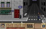 Crime Does Not Pay Atari ST Shang is ready to shoot the policeman in the head