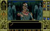 WaxWorks DOS Fighting a zombie. Click the area you wish to strike.