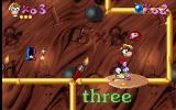 Maths and English with Rayman: Volume 3 DOS The red blob with a 'P' on it is a power up that boosts Rayman's fist power.