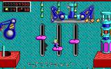 Commander Keen 5: The Armageddon Machine DOS Commander poses for the camera! Deadly spikes below. Time your jumps well (EGA)