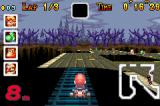 Mario Kart: Super Circuit Game Boy Advance Mario using the little invisible bridge as a shortcut at Boo Lake.