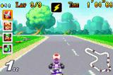 Mario Kart Super Circuit Game Boy Advance Race leader Toad about to be hit by an unstoppable purple shell at Mario Circuit.