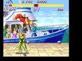 Super Street Fighter II FM Towns Ken is trying to out-jump Ryu in the American harbor