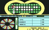 Wheel of Fortune Commodore 64 The hostess goes across the board to flip a tile