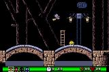 Fury of the Furries Amiga Village level 10 - in this stage exit, hazard and direction boards look different than in other levels.